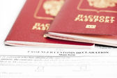 Two passports are on the passenger custom declaration — Stock Photo
