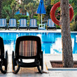 Стоковое фото: Chaise lounge by pool to relax in villa
