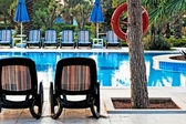 Chaise lounge by the pool to relax in the villa — ストック写真