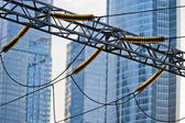 Power lines on the background of modern office buildings. — Stock Photo
