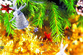 Silver bell hanging on the branch of a Christmas tree — Stock Photo