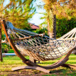 Hammock to relax in the tropical garden. — Stockfoto