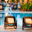 Chaise lounge by the pool to relax in the villa. — Stock Photo
