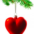 Christmas tree decorations in the form of heart on a Christmas tree branch. — Stock Photo