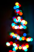 Lights Christmas tree garland in defocus. — Stock Photo