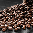Stock Photo: Coffee beans scattered on black grooved