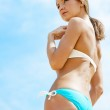 Sexy girl in a bathing suit against the sky. — Stock Photo