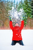Female throwing a pile of snow up into the air. — Stock Photo