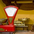 Red kitchen scales in the old style - Stock Photo