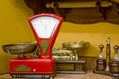 Red kitchen scales in the old style — Stock Photo
