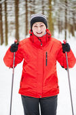 Portrait of a happy woman with ski poles — Stock Photo
