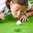 Girl cheating in the game of golf — Stock Photo #19971077