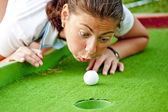 Girl cheating in the game of golf — Stock Photo