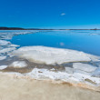 Melting ice on the lake during the ice drift. — Stock Photo