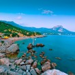 Rocky beach at dusk. Bay of of Laspi, Crimea. Ukraine - Stock Photo