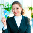 Young happy business woman with a CD in hand — Stock Photo