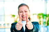 Young happy businesswoman shows that everything is fine — Stock Photo