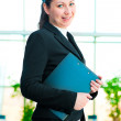 Young happy business woman holding a folder office  — ストック写真
