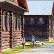 facades russian village of wooden houses in the old style — Stock Photo