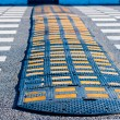 Stock Photo: Yellow and Black Speed Bump on asphalt.