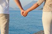 Loving couple holding hands — Stock Photo