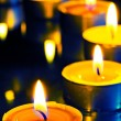 A group of small candles on a dark background — Stok fotoğraf