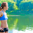 Shapely, toned woman in sportswear rest on the nature — Stock Photo