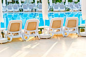 Empty chairs stand around the pool at the hotel — Stock Photo