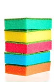 Tower of colorful sponges for ware on a white background — Stok fotoğraf