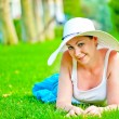 Girl lies on the grass and looking at the camera — Foto de Stock