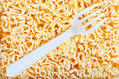 Disposable fork on instant noodles close up — Stock Photo