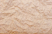 Old wrinkled brown paper close-up, background — Stock Photo