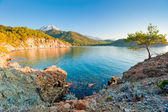 A beautiful bay with clear water and mountains — Stock Photo