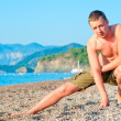 Stock Photo: Mwith naked torso in for sports at sea