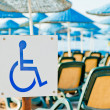 Sign wheelchair close-up on the beach — Stock Photo