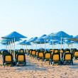 Stock Photo: Neat rows of sun loungers on beach