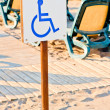 Sign wheelchair set on the beach by the sea — Stock Photo #33228911