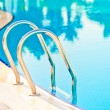 Descent into pool at hotel — Stock Photo #33533703