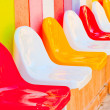 A number of multi-colored seats for children — Stock Photo