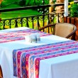 Table covered with a tablecloth in a restaurant with Turkish ornament — Stock Photo #33533791