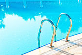 Steps leading to the pool and reflection in water — Stock Photo