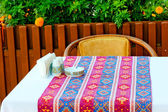 A table covered with a cloth with oriental patterns — Stock Photo