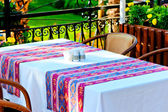Table covered with a tablecloth in a restaurant with Turkish ornament — Stock Photo