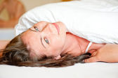 Beautiful girl on the bed in the morning serene vulnerable — Stock Photo