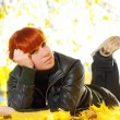 Stock Photo: Womwith red hair rest in autumn park