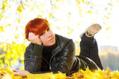 Woman with red hair a rest in autumn park — Stock Photo
