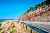 Highway guardrail in the mountains and beautiful rock — Stock Photo
