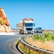 Oncoming traffic truck and car in mountains — Stockfoto #35353293