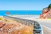 Sea and mountain highway fenced striker — Stock Photo