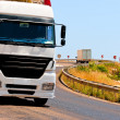 Dangerous turns and loaded trucks in the mountains — Stock Photo
